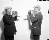 External link: Mr. Rhoads and an unidentified photographer face each other with cameras in hand, probably at the Rocky Mountain News office in Denver, Colorado.
