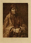 volume 1 facing: page  76 The blanket maker - Navaho - photogravure plate
