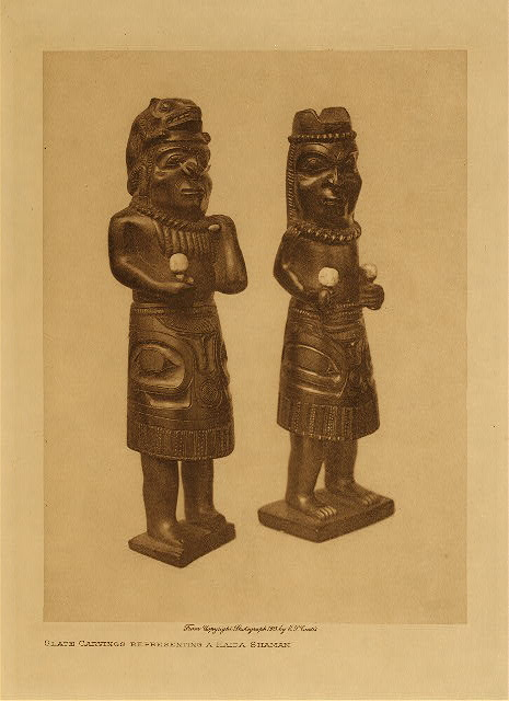 volume 11  facing: page  136 Slate carvings representing a Haida shaman