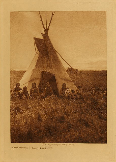 volume 18  facing: page  14 Berry-pickers in camp - Chipewyan