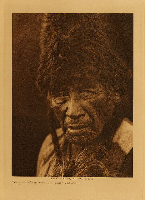 "volume 18  facing: page  156 Oksoy-Apiw - ""Raw-eater Old-man"" - Blackfoot"