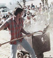 Man participating in the Mucking Contest, n.d.