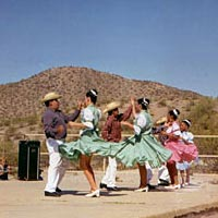 Members of Ballet Folklorico Mexicapan perform May 16, 1999