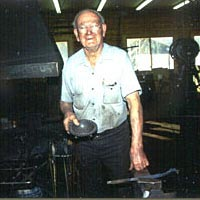 Francis Whitaker at his forge, February 1994