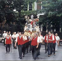 Society members carrying statue of St. Andrew, 1995