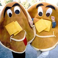 Two Land o' Lakers dressed as pancakes