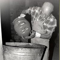 C. J. Meaders glazing a face jug