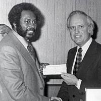 Gov. Julian Carroll presenting check for building to W.C. Young, 1975