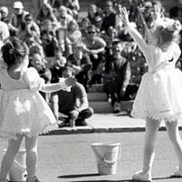 Two very young dancers delight the crowd at the Festival, October 1999