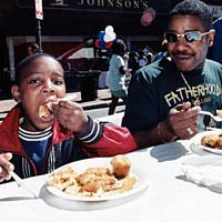 Father and son feast on pancakes, May 15, 1999