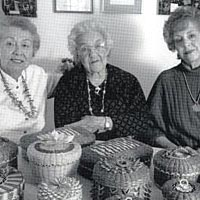 Mary Gabriel with daughters Clare and Sylvia and their baskets
