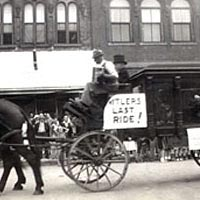"Parade entry - hearse bearing sign ""Hitler's Last Ride"" from early 1940s"