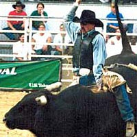 PRCA Rodeo action includes bull riding