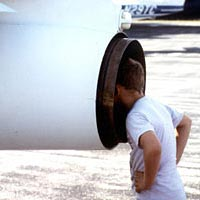 Young boy gets an up-close look at a T-33 jet