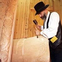 Woodcarver Phillip Odden demonstrates his woodcarving skills at Hostfest, November 1996