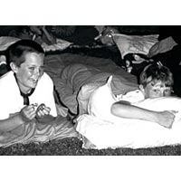 "Two boys in sleeping bags at the ""Ghosting,"" June 1998"