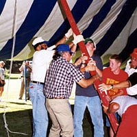 Plainview residents of all ages help to erect the Chautauqua tent , July 1999