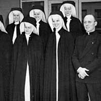 Original pioneering group of Sisters with Father Moran