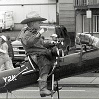 Boy riding rocket in Loyalty Days Parade, May 1999