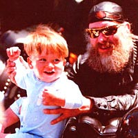 Biker and toddler enjoy the parade, 1996