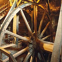 Wooden gear, 24' in diameter, used to create pressurized air in the blowing tubs