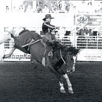 Saddle bronc riding event