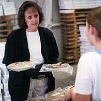 Melody Weaver sells donated pies.