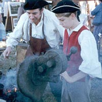 Blacksmithing at colonial-era forge