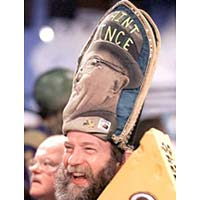 "Enthusiastic fan wearing hat canonizing ""St. Vince"" Lombardi, Packer coach"