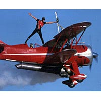 Pilot Jim Franklin and his wingwalker son Kyle perform in their Waco biplane, 1997