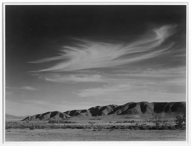 Manzanar landscape with barbed wire fence, by Ansel Adams image: loc.gov
