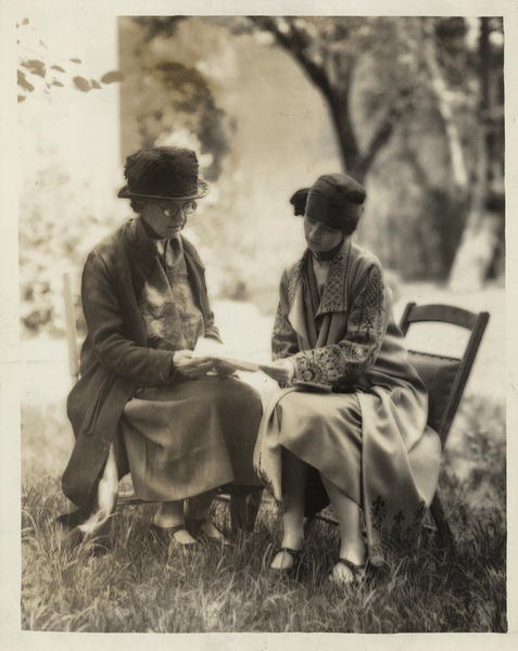 Miss Zonia Baber, representative in United States of the women of Porto Rica (Puerto Rico), consulting with Mrs. Burnita Shelton Matthews, Legal Research Secretary of the National Woman's Party, on the drafting of a bill for introduction in Congress extending suffrage to the women of Porto Rica. Image and caption courtesy National Woman's Party Records/Library of Congress.