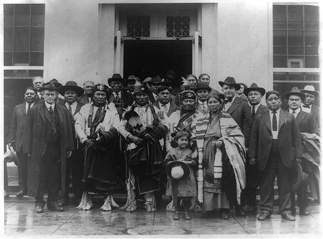 Group of Osage Indians posed outside the White House