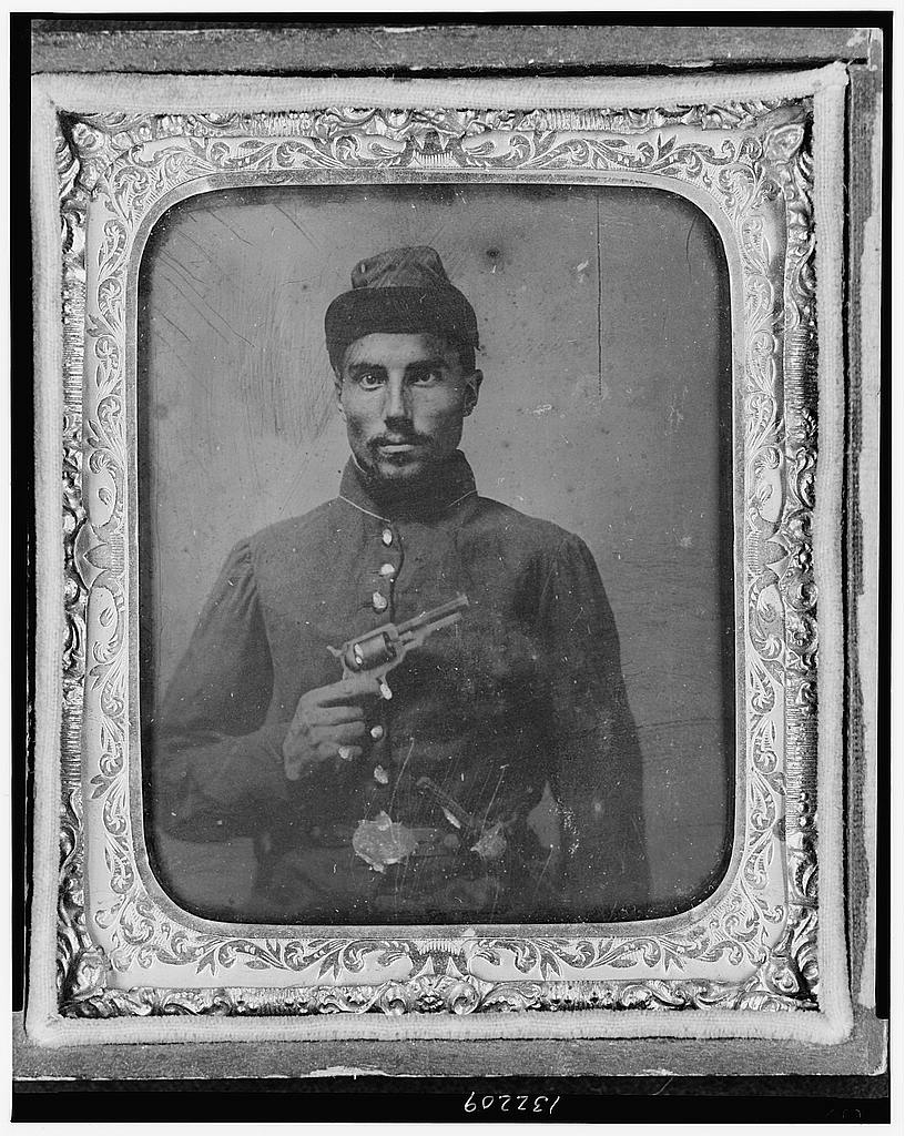 Figure 7. Seated black soldier with pistol and jacket. Library of Congress.