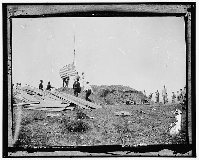 Hoisting the flag at Guantanamo, Cuba, June 12, 1898.  Image from the American Memory Collection at the Library of Congress