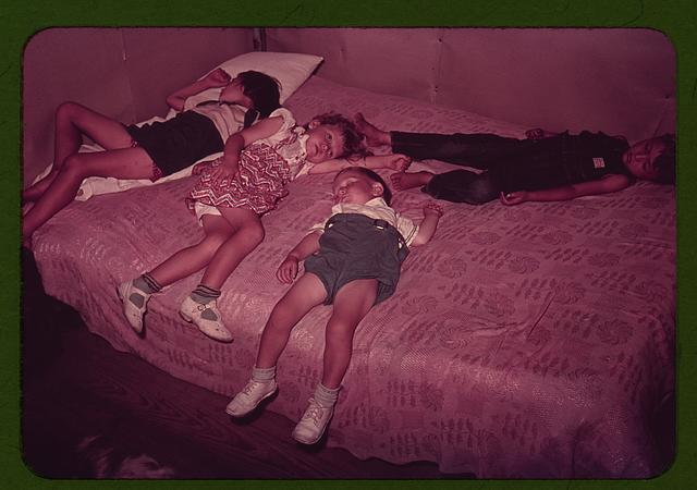 Children asleep on bed
