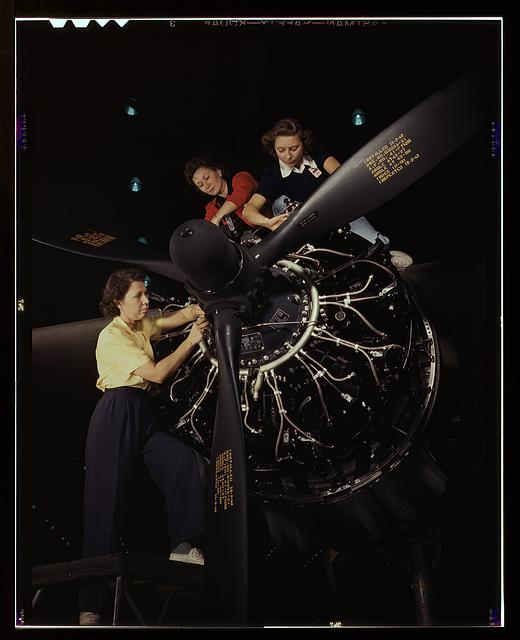 Careful hands of women are trained in precise aircraft engine installation