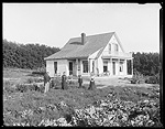 Family in front of a farm house, Dawson County, Nebraska.
