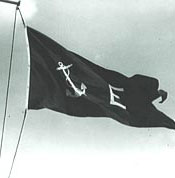 "Image: The New Navy ""E"" Pennant Flying from a Yardarm"