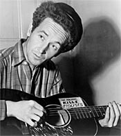 Image: Woody Guthrie playing guitar