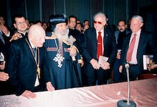 [ Ragheb Moftah, His Holiness Pope Shenouda III, a Coptic dignitary, and American University in Cairo President, John Deuel Gerhart, at Ragheb Moftah's 100th birthday celebration], December 21, 1998