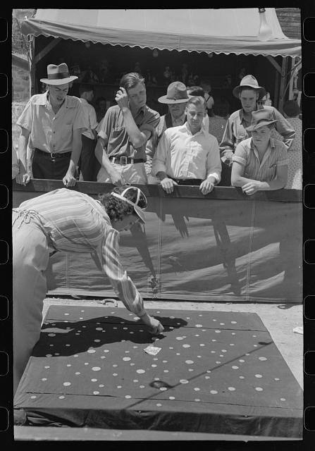 Tossing coins concession.  Vale, Oregon.  July, 1941.  Library of Congress.  Russell Lee, photographer.
