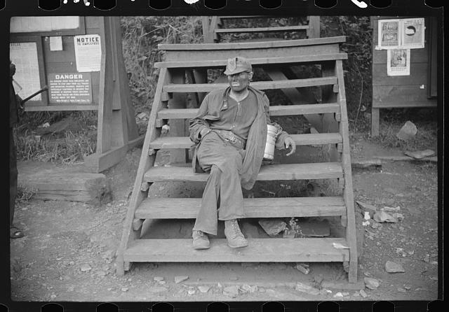 Coal miner waiting for lift home. Caples, West Virginia