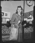 """I'll carry mine."" Betty Jane Rhodes, popular Paramount Pictures star, shops and carries her own parcels, . . ."