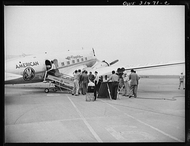 "A scene at the American Airlines ""Flagship"" passenger plane, showing moving picture and sound equipment being used during the filming of ""Black Marketing,"" a motion picture produced by the U.S. Office of War Information (OWI) and released August 19, 1943"